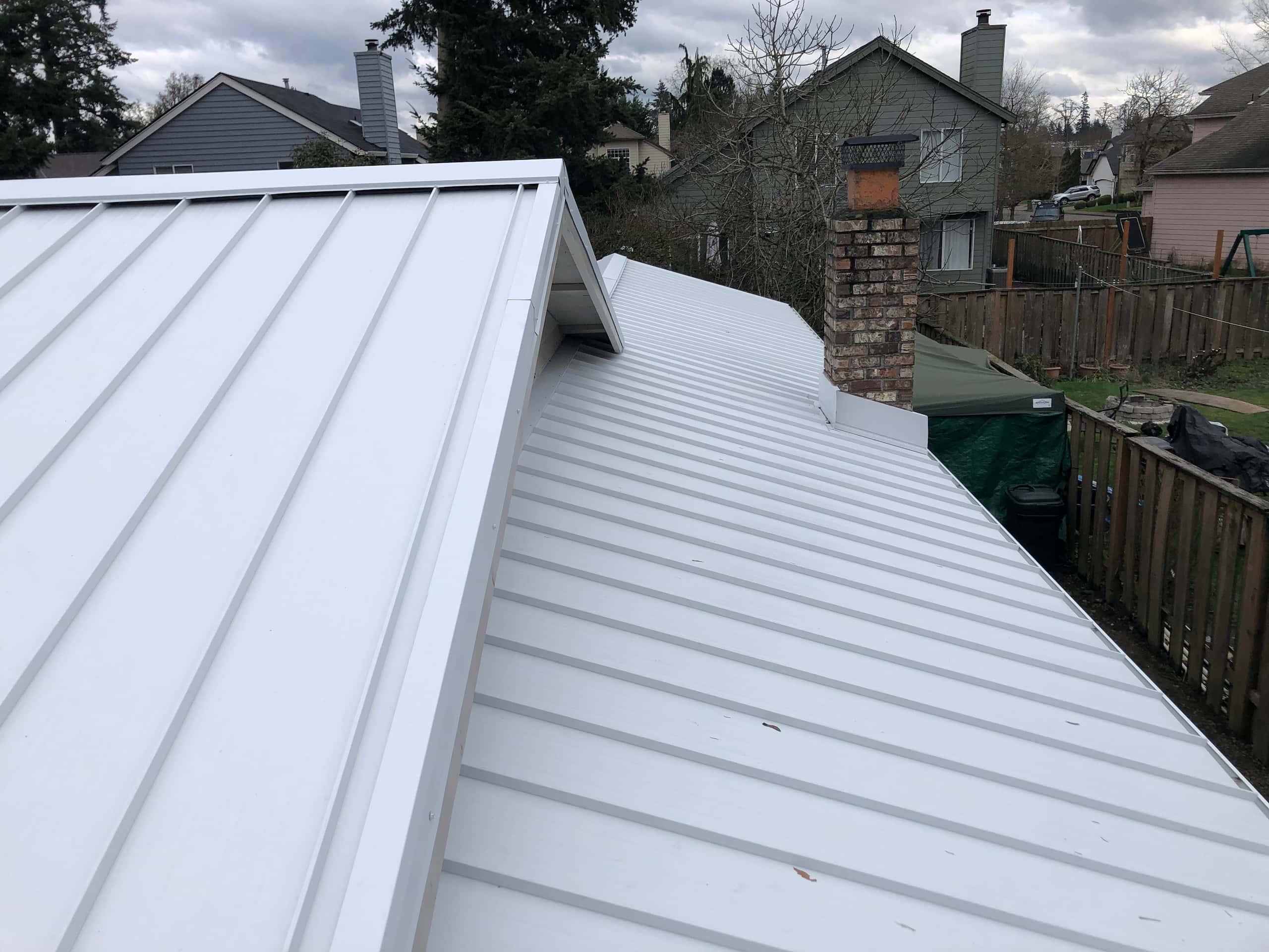 Reliance Roof Pros LLC | Beaverton | New Roof | Taylor Metal 24 Gauge Kynar | Glacier White | Top