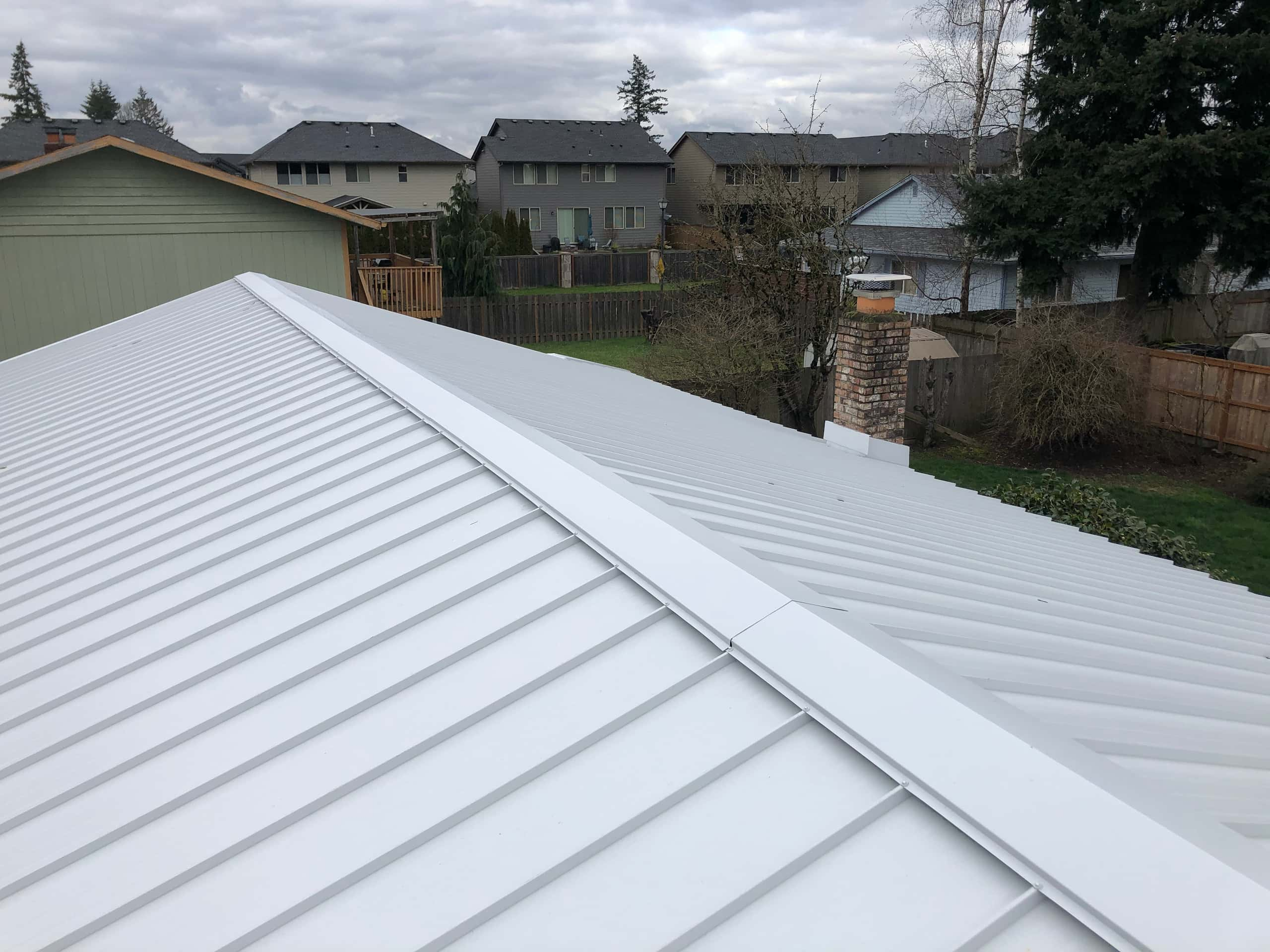 Reliance Roof Pros LLC | Beaverton | New Roof | Taylor Metal 24 Gauge Kynar | Glacier White | Ventilation Ridge